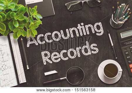 Accounting Records Handwritten on Black Chalkboard. Top View of Black Office Desk with a Lot of Business and Office Supplies on It. 3d Rendering. Toned Illustration.