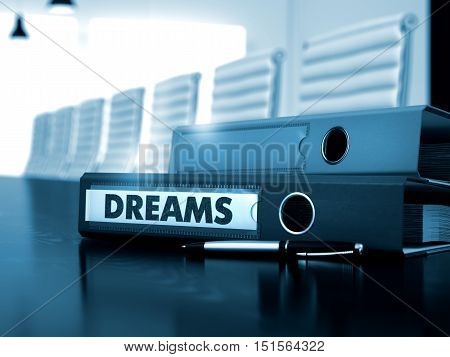 Dreams - Business Concept on Blurred Background. Dreams. Business Concept on Toned Background. Binder with Inscription Dreams on Black Desk. 3D.