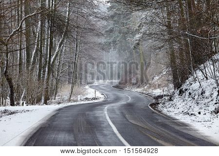 Winter country road with snow, snowy, slippery surface, drive carefully