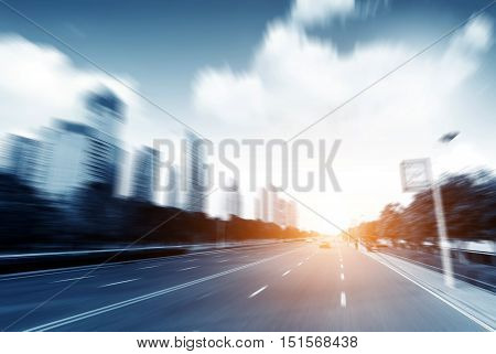 High-speed cars in the city on the road