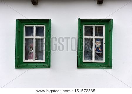 Dolls In The Window In A Rural House