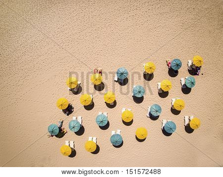 Sunbeds And Umbrellas On Hot Sand