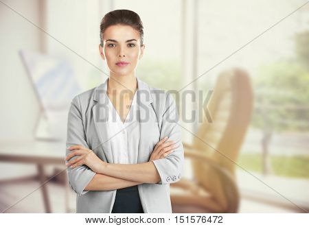 Beautiful woman on blurred office background. Lawyer and notary concept.