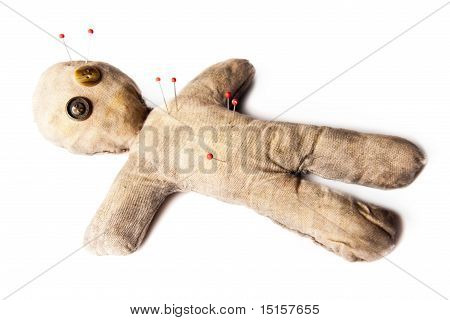 Creepy Voodoo Doll With Needles Isolated On White
