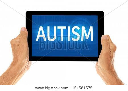 Children autism concept. Old man holding tablet on a white background