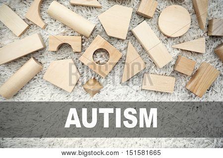 Children autism concept. Wooden children's building blocks on carpet