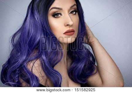 young girl long with purple hair posing