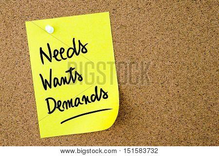 Needs, Wants, Demands Text Written On Yellow Paper Note