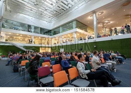 Moscow, Russia - September 3, 2016: People attend Digital Marketing Conference in big hall of Mail.ru internet company