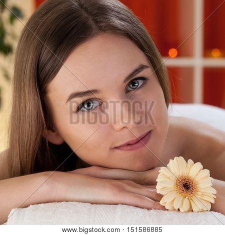 Beautiful lady before massage at beauty salon