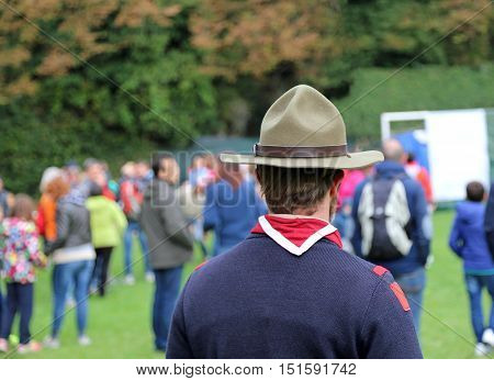 Scout Leader At International Gathering In Uniform With Campaign