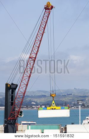The crane lifting container in Napier town port (New Zealand).