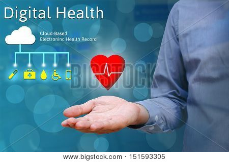 Closeup of hand man show holding heart in palm Digital health concept.