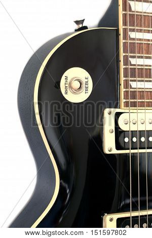 Part of black electric guitar color isolated on white background vertical view closeup