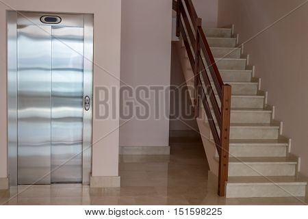 image of view of the staircase with elevator in apartment house