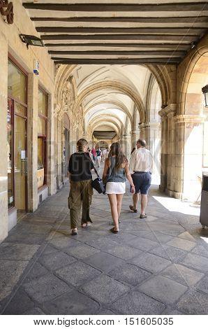 SALAMANCA, SPAIN - AUGUST 3, 2016: People walking under a gallery in Main Plaza Salamanca Spain