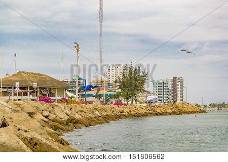 SALINAS, ECUADOR, OCTOBER - 2015 - Rock breakwater coastline at Playa de Chipipe Salinas Ecuador