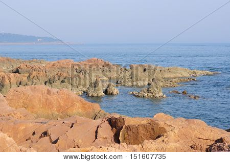 The rocky coast of Qingdao china overlooking the Yellow sea in Shandong province.