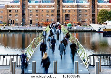 London UK - September 21 2016 - People crossing the North Dock Footbridge from Canary Wharf to West India Quay