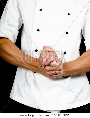 Professional Chef With A Hand Gesture Towards, Wearing A Chefs Jacket