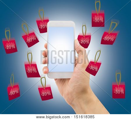 hand showing the smartphone with rain of falling prices .All screen content is designed by us and not copyrighted by others and created with wacom tablet and ps