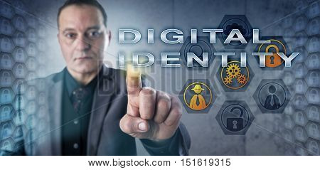 Businessman in gray suit with intent look touching DIGITAL IDENTITY onscreen. Business metaphor and information technology concept for identity management digital identifiers and authentication.