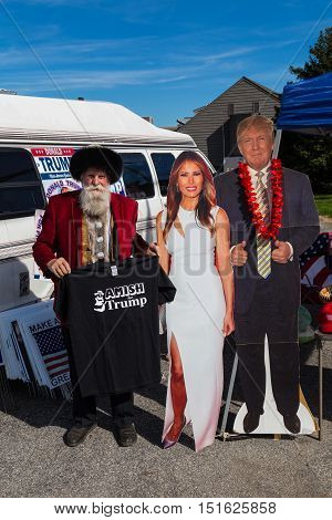 Ronks PA USA - October 11 2016: Standing with cutouts of Donald Trump and his wife a vendor holds Amish for Trump shirts for sale in Lancaster County.