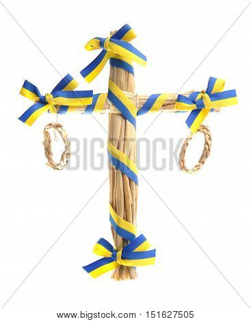 Maypole of straw with yellow and blue bands in the Swedish colors as decoration for table settings. Isolated on white background.