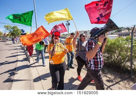 Marchers With Colorful Flags At Border Protest