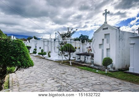 San Lazaro Cemetery Antigua Guatemala - November 2 2014: Tombs on All Souls' Day in cemetery of Spanish colonial town of Antigua.