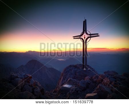 Peak Of Hoher Göll. Iron Cross At Mountain Top In Alp At Austria Germany Border.