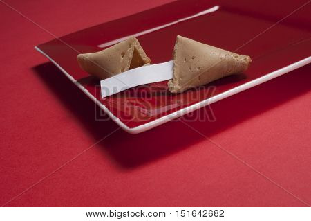 Opened Fortune Cookie On Square Red Plate
