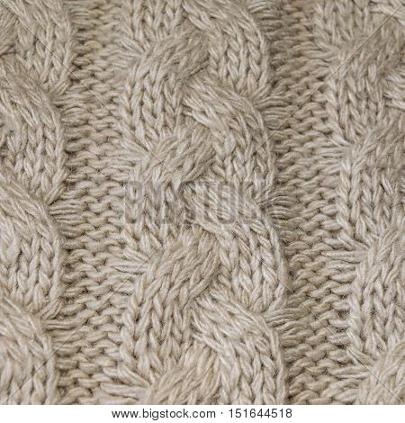 Texture artificial wool with knitting patterns. Close-up.
