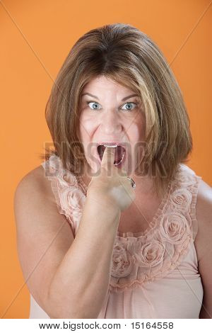 Woman Gestures To Throw-up