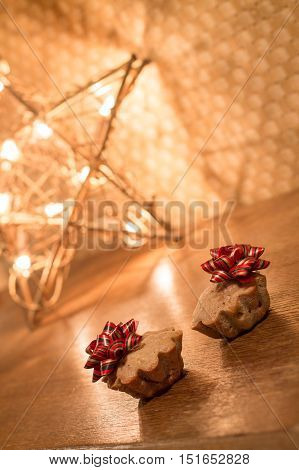 Two muffin with apples and cinnamon with bow on wood table near Star light. Gift for Valentines day.