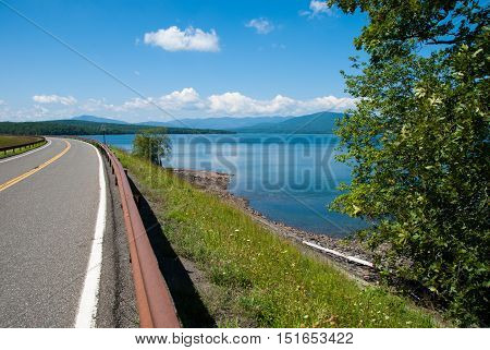A view of the Ashokan Reservoir and Dike Road with the Catskill Mountains in the background.