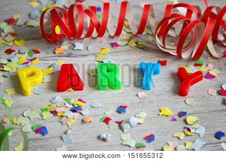 Colorful Letters and confetti _ Party. Shot in Studio.