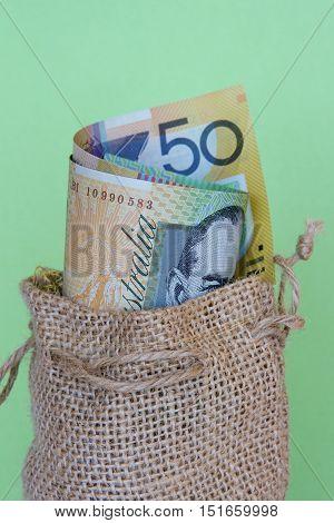 Australian dollars in a brown hessian sack.