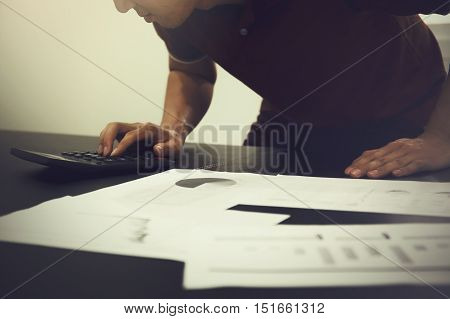 Business Man Working On Accounting, Marketing, Planning, Budgeting With Financial Documents On Table