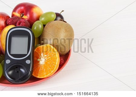 Glucometer And Fresh Fruits On Plate, Diabetes And Healthy Nutrition, Copy Space For Text