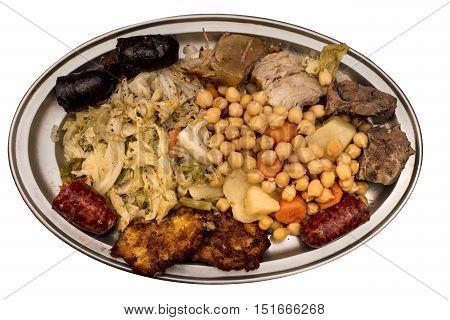 A photo of cocido madrileno, traditional Spanish dish with chickpeas. meat, sasuages, and vegetables, in a typical dish, isolated on white