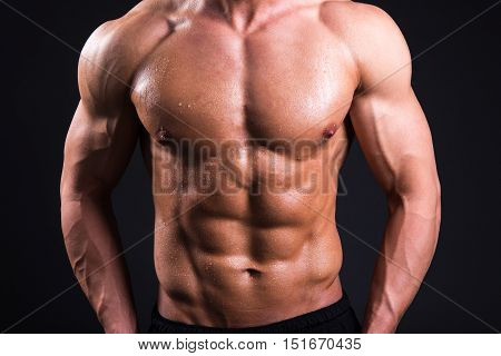 Sweat Body Of Young Sexy Muscular Man Standing Over Grey