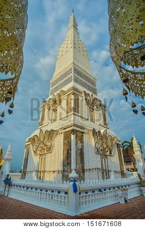 Golden pagoda and temple at Tra UthenNakorn Phanom;Thailand with blue sky.