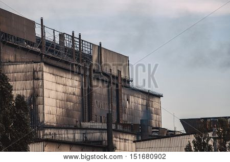 Working old factory during production. Emissions of harmful substances into the atmosphere pollution.