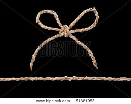 Close up rope bow isolated on black background