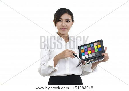 Asian young professional businesswoman applying makeup cosmetics