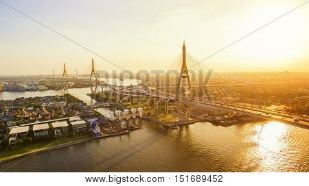 sun light and bhumiphol bridge crossing chaopraya river in bangkok thailand