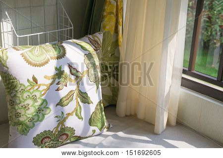 resting area of a cozy window seat with cushion in the morning horizontal composition