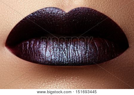 Close-up Shot Of Woman Lips With Glossy Plum Lipstick. Perfect P