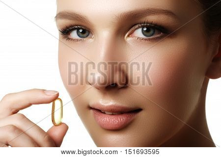 Portrait Of Woman With Omega 3 Fish Oil Capsule, Outdoors. Food